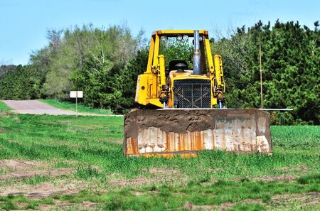 Quiet Bulldozer isolated on the field
