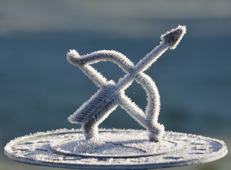 Frozen Sundial on a winters morning with Ice crystals