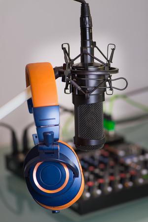 head phones: Microphone in the recording studio on a mixer head phones Stock Photo