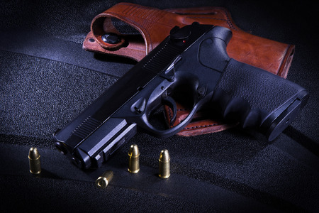 holster: Gun and holster with bullets Stock Photo