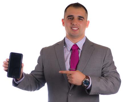텍스트가있는 그의 전화를 가리키는 비지니스 정장을 입은 남자 스톡 콘텐츠