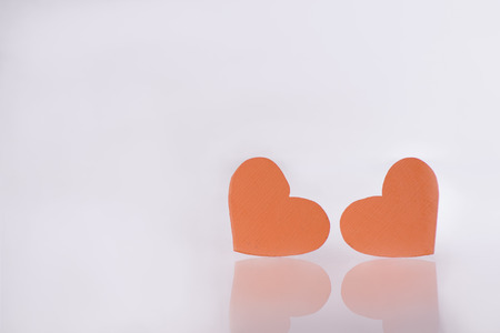 room for text: Two hearts with white a white background, room for text on the hearts or on the backdrop.  Valentines  day
