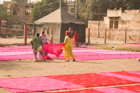 dyeing: 30th November 2015, Jodhpur, Rajastan, India. Traditional process of dyeing pink ad red cloth. Exploring the delights the Blue City of Jodhpur has to offer
