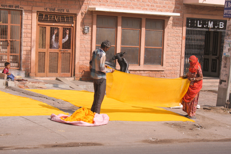 dyeing: 30th November 2015, Jodhpur, Rajastan, India. Traditional process of dyeing yellow cloth. Exploring the delights the Blue City of Jodhpur has to offer