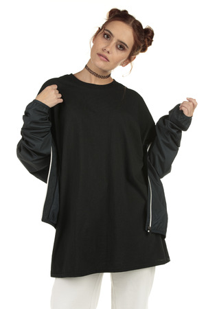 Fashionable streetwear model wearing an extra large t-shirt dress and leggings with copy-space to display your graphics