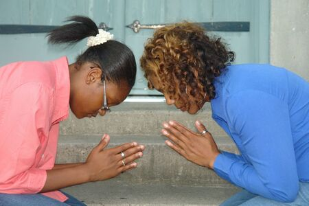 Picture of mother and daughter praying Stock Photo - 3759656