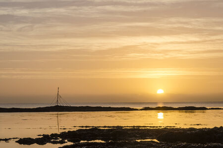 sunrise with reflectionat hannafore point, cornwall, uk Banco de Imagens - 26813464