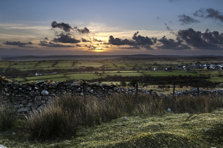 The sunlight fades over the moor  ,as seen from Caradon Hill, Cornwall, UK Banco de Imagens