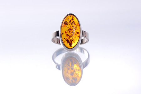 Ladies silver ring with amber stone with reflection Banco de Imagens - 33786188