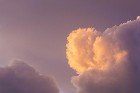 Pink purple yellow lit clouds at sunrise Banco de Imagens - 33898283
