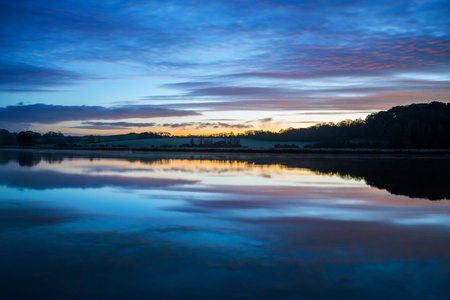 Sunrise on the river lynher with beautiful sky and  reflections at st germans, cornwall, uk