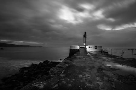 moody skies over the banjo pier looe ,cornwall, uk Stock Photo