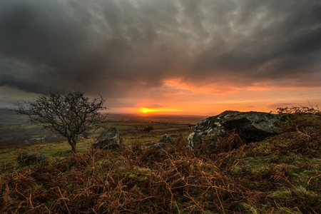 Gloomy dark sunrise seen from caradon hill, cornwall, uk
