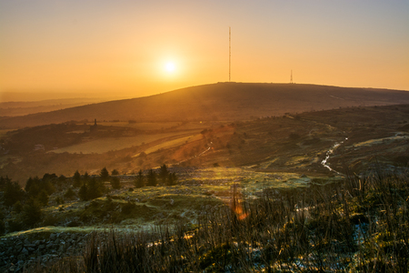 Sunrise over Bodmin moor at Stowe's Hill with clear sky and  Caradon hill and mast in view