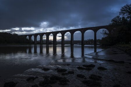 viaduct silouette with moody sky ,st germans ,cornwall