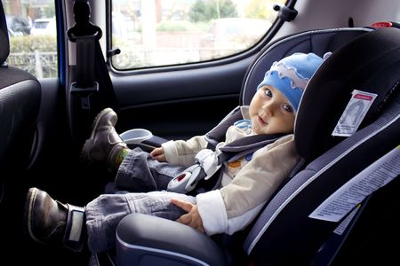 A child in baby car seat photo
