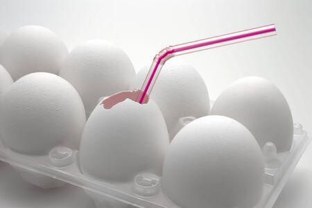 White eggs in plastic box