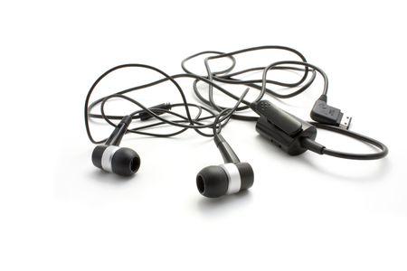 aural: Black headphones. Isolated.