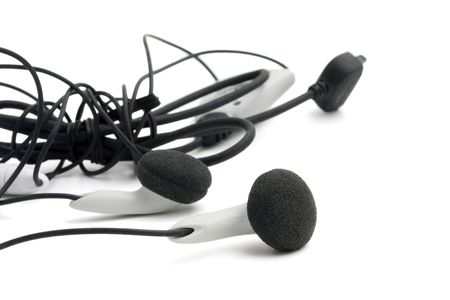 aural: White headphones.