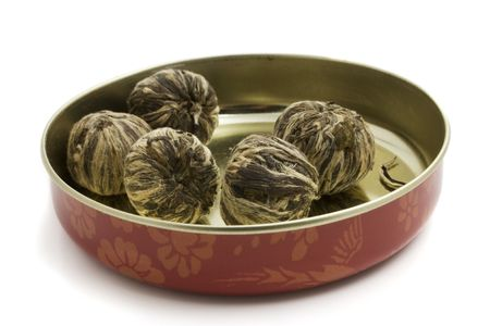 The leaves of green tea braided in balls photo