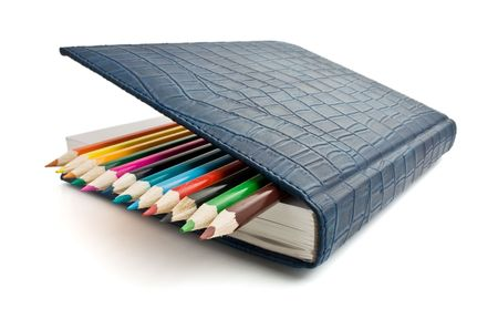 pencil and notebook isolated photo