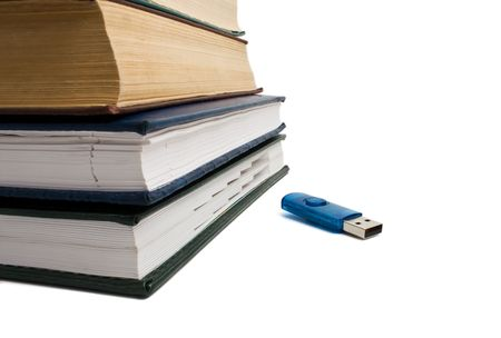 stack of books and flash drive photo