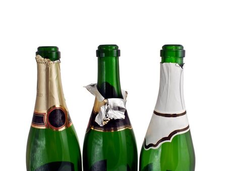 gold capped: three champagne bottles isolated on a white Stock Photo