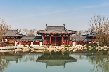 HUAQING, CHINA, 25 DECEMBER 2017: Landscape of a lake and a traditional chinese temple in Huaqing Palace Editorial