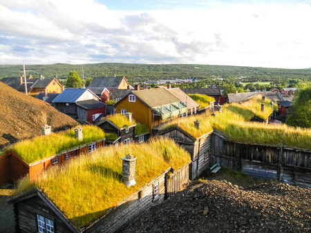 Traditional wooden houses with peat on the roof in the village of Roros, Norway Reklamní fotografie