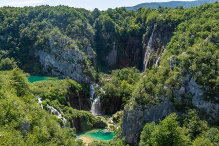 Little colorful lake and beautiful waterfalls in Plitvice Lakes National Park, Croatia