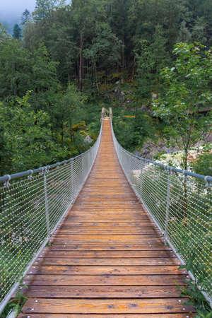 The Hangebrucke, hanging wooden bridge in the forest of Berchtesgaden National Park in Germany