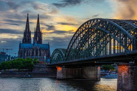 COLOGNE, GERMANY, 23 JULY 2020: Colorful sunset over Cologne Cathedral and Hohenzollern Bridge Redakční