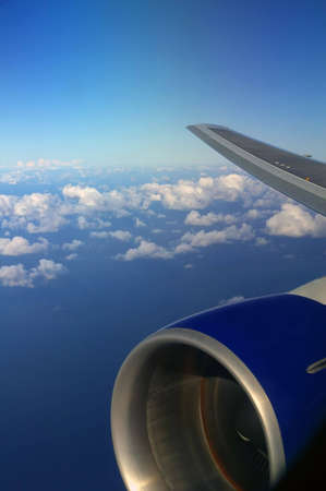 Plane Wing with sky and ocean background