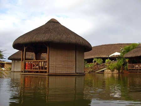 islets: Restaurant dining tables and islets on artificial tropical pond