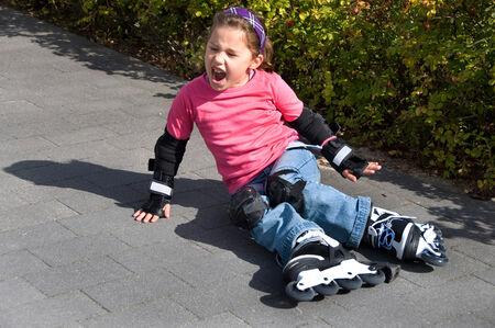 Girl crashes on roller-skating Stock Photo - 25268528
