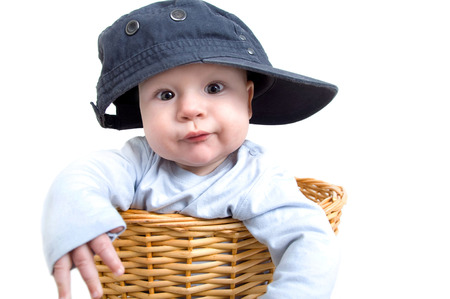 Baby exempted as a rapper with baseball cap in the laundry basket photo