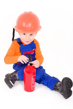 optionnel: Petit gar�on comme pompier avec une poudre de l'extincteur, en option