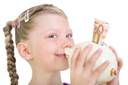 sparingly: Girl kissing piggy bank