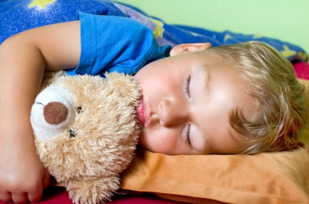 Little blond sleeping boy with stuffed animalschlafender junge photo
