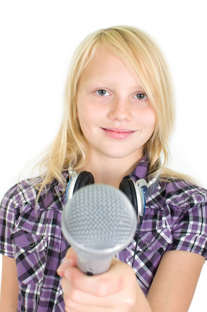 Girl holding microphone in the camera Stock Photo