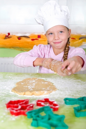 little girl bakes cookies  Stock Photo - 25270545