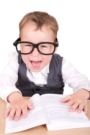 mensch: little boy with glasses reading Stock Photo