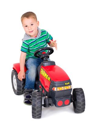 little boy driving pedal car Banco de Imagens
