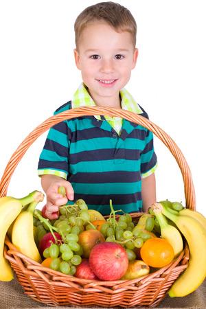 little boy with a basket of fruits Banco de Imagens