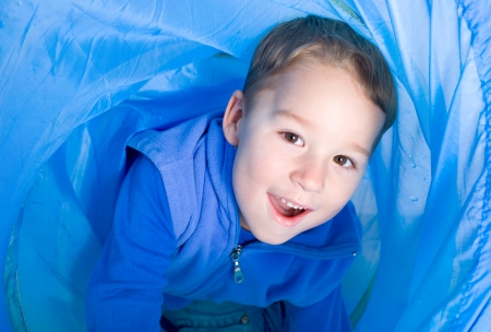 little boy in a crawling tunnel Stock Photo - 25270783