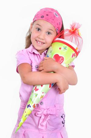 girl with pink dress an school cone Banco de Imagens