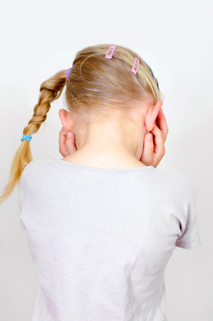 despite: little girl turns away and keeps the ears