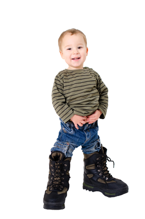 adult footprint: Little boy with too big shoes