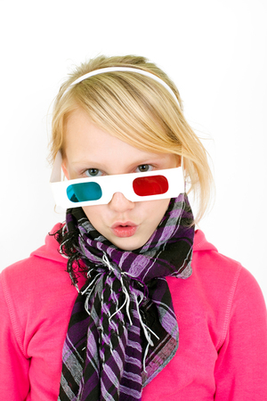 Blond girl with 3D glasses looks funny; photo