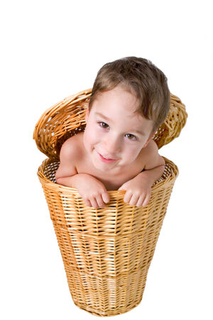 Funny Boy in a basket looks into the Camera photo
